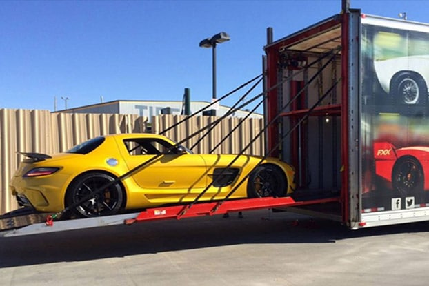 yellow luxury sports car for enclosed transport